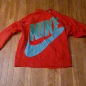 Orange Nike sweater